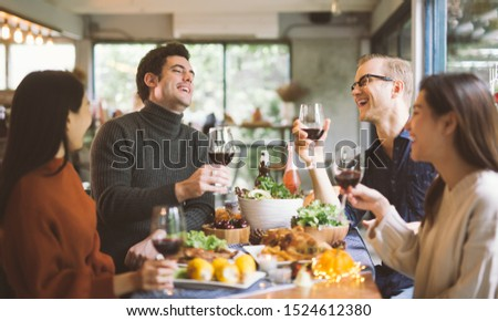 Dinner with friends. Group of young people enjoying dinner together. Dining Wine Cheers Party thanksgiving Concept #1524612380