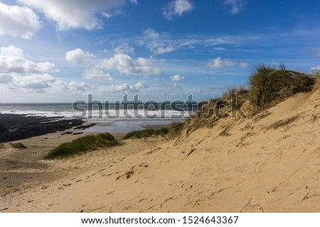 Croyde bay beach and sand dunes in North Devon Royalty-Free Stock Photo #1524643367