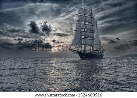 Sailing ship under white sails and stormy sunset sky. Yachting. Travel #1524680516