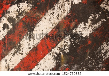 Striped damaged texture with cracks and white-red stripes.Post-apocalyptic background with colorful stripes. Destroyed sign dimensional transport with cracks and spots. Royalty-Free Stock Photo #1524730832