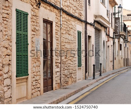 Mallorca, Spain - September 2019: Street view of Santanyí,  a small medieval walled town  located in the southeast of the island.  #1524750740
