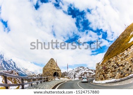 Grand Austrian Alps. Gorgeous Grossglocknerstrasse. Decorative turret at the turn of the road. Dizzy turns of mountain serpentine. The concept of active, ecological and photo tourism #1524757880