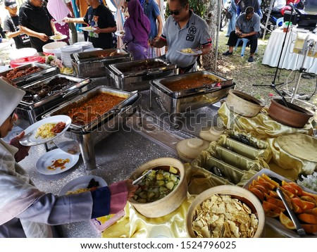 Klang, Malaysia - 4 August 2019 : Variety choice of food for guests at the wedding ceremony in Klang, Malaysia with selective focus.  #1524796025