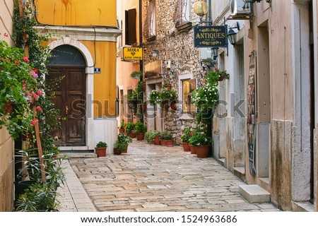 POREC, CROATIA - August 8th, 2019: Empty street of old town early in the morning #1524963686