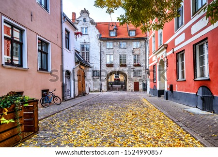 Autumn on medieval street in old Riga. The city is capital of Latvia that is well known to be a very popular tourism destination in the Baltic region  #1524990857