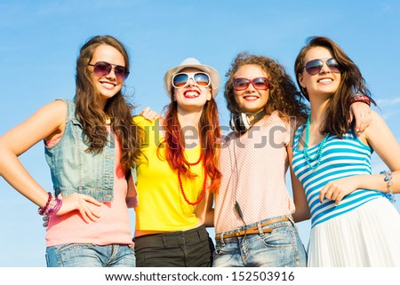 group of young people wearing sunglasses and hats hugging and standing in a row, spending time with friends #152503916