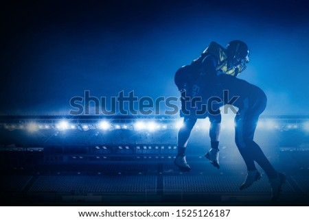 American football players on stadium in action #1525126187