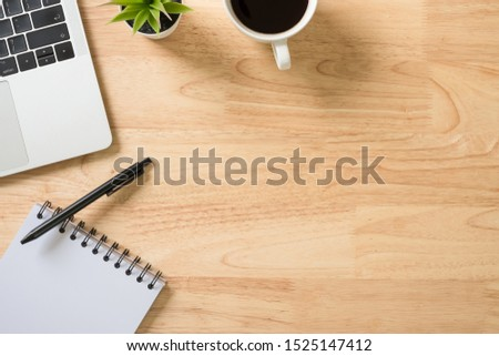 Flay lay, Top view office table desk with laptop computer, keyboard, notepad, coffee, pen and green plant with copy space background. #1525147412