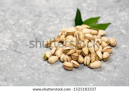 Heaps of pistachio nuts . Used to prepare ice creams, beverages or as condiments for first and second courses. #1525183337