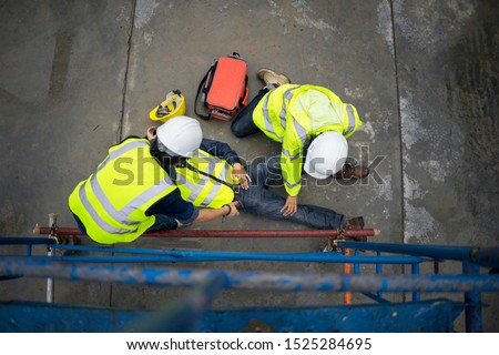 Basic first aid training for support accident in site work, Builder accident fall scaffolding to the floor, Safety team help employee accident. #1525284695