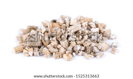 Exfoliated vermiculite mineral, isolated on white background. Mineral used in gardening. #1525313663
