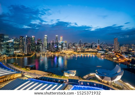 Aerial view of Singapore business district skyline with tourist sightseeing in night at Marina Bay, Singapore. Asian tourism, modern city life, or business finance and economy concept #1525371932