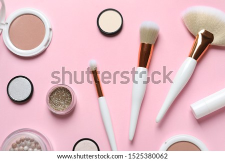 Flat lay composition with makeup brushes on pink background #1525380062