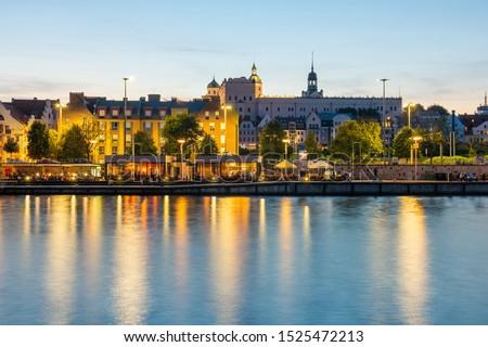 Szczecin. Night view from across the river to the illuminated historic center. Odra river. Chrobry embankments in Szczecin Royalty-Free Stock Photo #1525472213