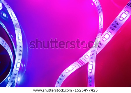 Bright neon LED strip glows blue and pink. Copyspace. #1525497425