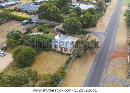 Aerial shot of the Cherry Plum Cottages. A small cottage in the Victorian coastal town of Port Fairy. Victoria, Australia. #1525522661