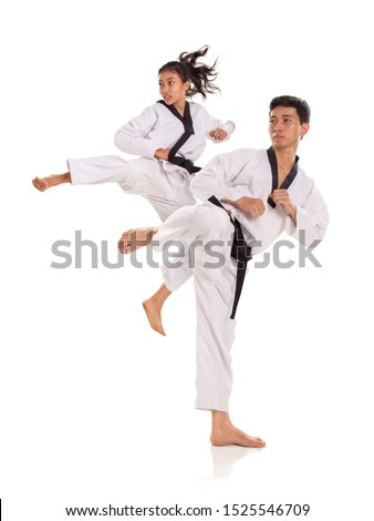 Portrait of tae-kwon-do team in action pose. Combat sports concept. Full length shot, isolated over white background #1525546709