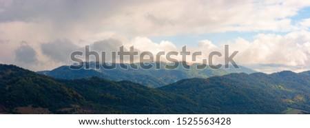 wonderful mountainous panorama in autumn. gorgeous cloudscape over the mountainwonderful mountainous panorama in autumn. gorgeous cloudscape over the mountain #1525563428