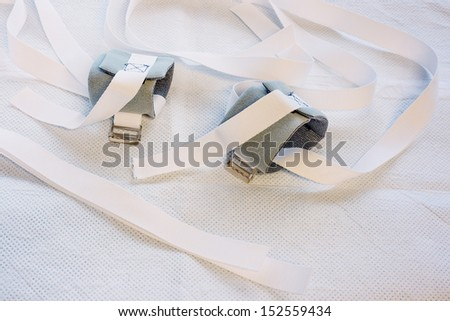 Wrist restraints on a hospital bed underpad Royalty-Free Stock Photo #152559434