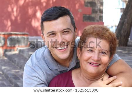 Hispanic senior woman with her son Royalty-Free Stock Photo #1525613390