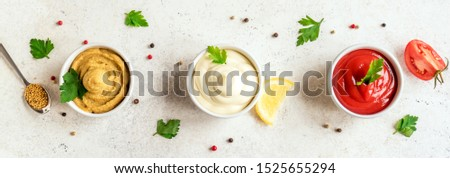 Set of popular american sauces -  ketchup, mayonnaise and mustard on white background, top view, banner. Three sauces. #1525655294