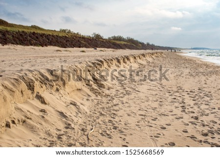 Sandy beach erosion, coastal erosion on the Baltic coast in Lithuania caused by wind and water. Loss or displacement of land. Climate change. Global warming #1525668569