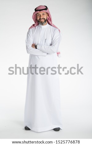 Arab middle eastern Saudi man in traditional formal thobe and Shimagh, on white isolated background, with different expressions, hand gestures and poses, studio lighting ready for cutout and editing. #1525776878