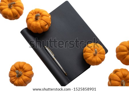 pumpkin background Halloween, scary pumpkin head or jack lantern cartoon on black notebook texture decorated with silver color pen, Halloween festival and thanksgiving concept design with copy space
