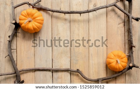 pumpkin background Halloween tree branch framework scary pumpkin head or jack lantern cartoon on vintage wooden wall texture, October Halloween festival and thanksgiving concept design with copy space