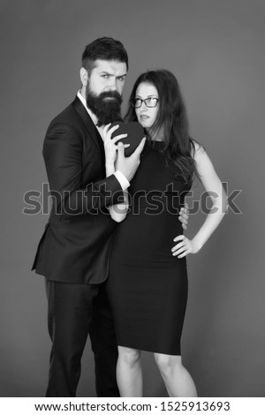 Valentines day holiday. Do not play with my heart. Man with beard and woman happy celebrate anniversary. Couple in love dating anniversary. Man tuxedo and girl hold hear soft toy romantic anniversary. #1525913693