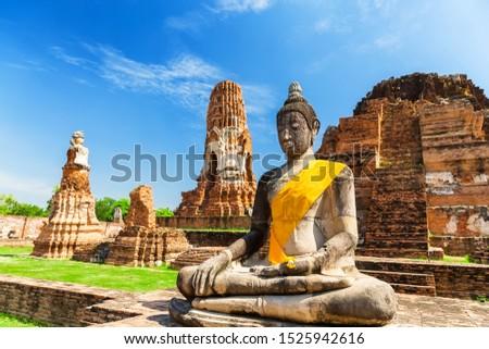 Wat Mahathat in Buddhist temple complex in Ayutthaya near Bangkok, Thailand. Buddha Silhouette of big buddha statue inside ruin temple at Sukhothai Historical Park. #1525942616