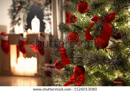 Beautiful decorated Christmas tree in living room #1526013080