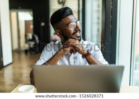 Skilled handsome male student of IT programming school making online practicing exercise in coding typing on laptop computer keyboard sitting in cafe #1526028371