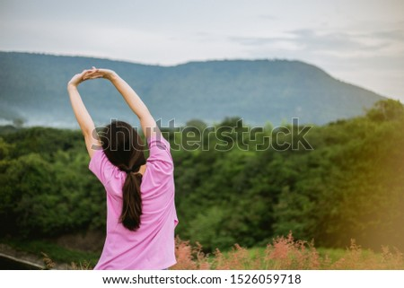 Asian woman traveler in forest and mountain relaxing in the morning. She felt very refreshed. Travel relax and refresh concept. #1526059718