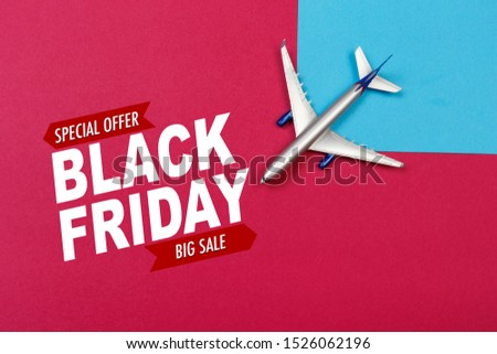 top view photo of toy airplane over color  background . Black friday sale- Image