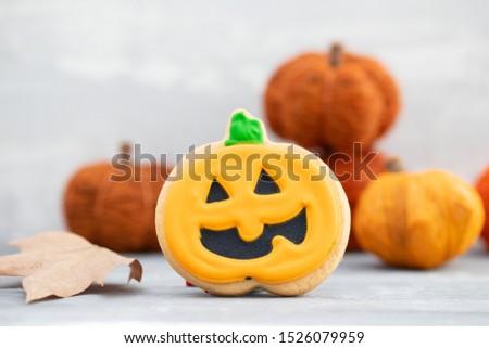 Halloween pumpkin cookies on ceramic background #1526079959