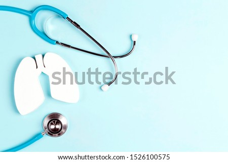 Prevention of pulmonary disease. Lung symbol and stethoscope a blue background with copy space for text. Healthcare and medicine concept.  Royalty-Free Stock Photo #1526100575