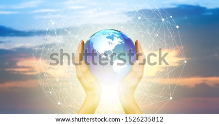 Abstract science. Hands touching earth and circle global network connection, data exchanges worldwide on city sunset background. Innovation. Creative and inspiration idea and Networking #1526235812