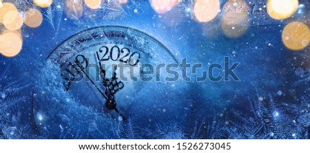 Happy New Years 2020. Winter Celebration With Dial Clock On Snow And Light #1526273045