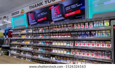 Yogyakarta - October 01, 2019: various kind of cigarette brands are sold at the convenience store. in the near future the government will double the price of cigarettes #1526326163
