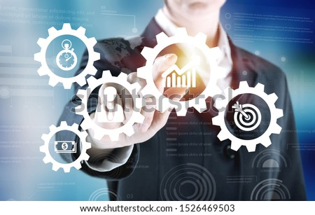 Business process management and workflow automation diagram with gears and icons with flowchart in background. Manager touching interface #1526469503