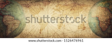 Ancient old globe on the vintage map background. Selective focus. Retro style. Science, education, travel, vintage background. History and geography team. Royalty-Free Stock Photo #1526476961