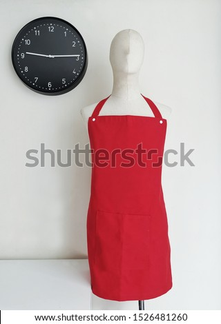 Red apron with Black Clock #1526481260