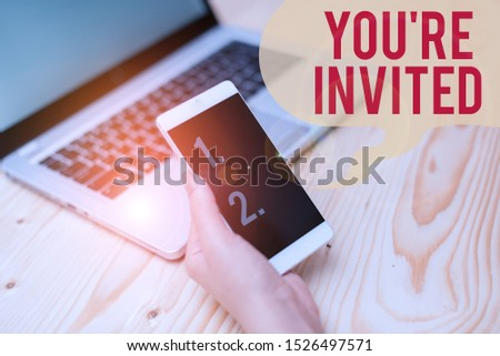 Word writing text You Re Invited. Business concept for Please join us in our celebration Welcome Be a guest woman laptop computer smartphone mug office supplies technological devices. #1526497571