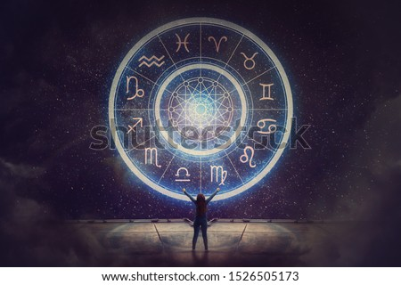 Woman raising hands looking at the night sky. Astrological wheel projection, choose a zodiac sign. Trust horoscope future predictions, consulting stars. Power of universe, astrology esoteric concept. #1526505173