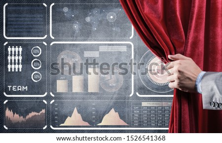 Hand opening red curtain and drawing business graphs and diagrams behind it #1526541368