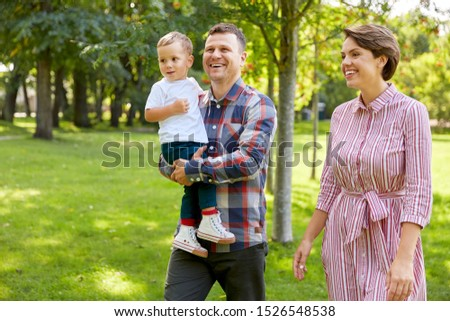 family, leisure and people concept - happy mother, father and little son at summer park #1526548538