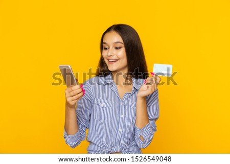 Happy surprised woman with phone and credit card. Shopping online concept. #1526549048