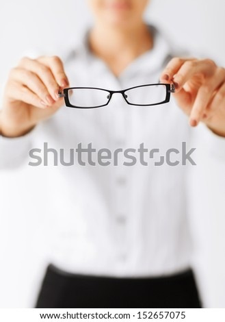 business and education concept - indoor picture of woman with eyeglasses #152657075