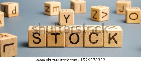Wooden blocks with the word Stock. Trading on the stock exchange. Investment portfolio. Capital gains. Common and preferred stocks. Market trading and pricing. Share price determination. #1526578352